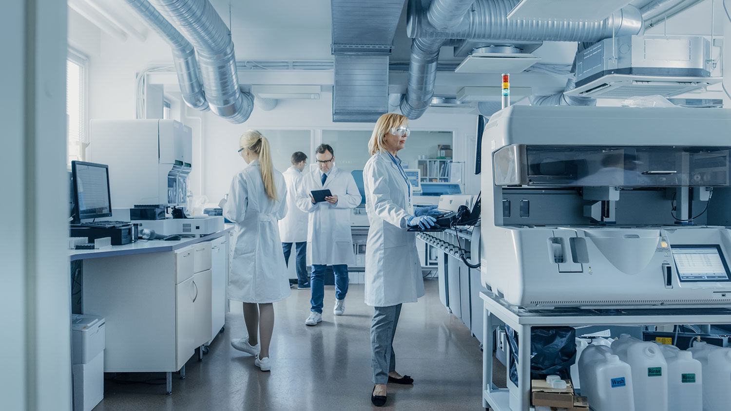ip ratings blog featured image, scientists in a lab running tests