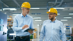 Industrial lighting specialists reviewing plans